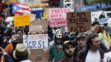 Members of the Occupy Wall Street movement take part in a protest march through the financial district of New York Oct. 12, 2011. (LUCAS JACKSON/LUCAS JACKSON/REUTERS)