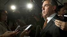 Environment Minister Jim Prentice speaks to reporters outside the House of Commons after Question Period on Oct. 6, 2009. (Adrian Wyld)