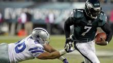 Philadelphia Eagles quarterback Michael Vick (R) avoids a tackle from the Dallas Cowboys linebacker Sean Lee during the first quarter of their NFL football game in Philadelphia, Pennsylvania October 30, 2011. The Eagles won 34-7. REUTERS/Tim Shaffer (Tim Shaffer/Reuters)