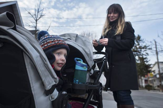 Three-year-old Benjamin Kleiman – shown with his mother, Amy Lazar Kleiman – was born in November, so he'll be much younger than the other children when he begins junior kindergarten in the fall.