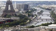 There are plenty of options for those looking to stay in Paris other than booking a hotel room. An aerial view of the Eiffel Tower (L) and the river Seine (R) in Paris on Bastille Day July 14, 2011. REUTERS/Charles Platiau (FRANCE - Tags: CITYSCAPE) (CHARLES PLATIAU/REUTERS)