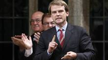 Canada's Immigration Minister Chris Alexander receives a standing ovation while speaking during Question Period in the House of Commons on Parliament Hill in Ottawa June 11, 2014. (CHRIS WATTIE/REUTERS)