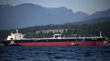 The AQUALEGEND crude oil tanker escorted by tugboats arrives at the Kinder Morgan Westridge marine terminal in Burnaby, B.C, Sunday, July 8, 2012. (Rafal Gerszak For The Globe and Mail)