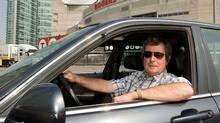Paul Beeston, president and CEO of the Toronto Blue Jays Baseball Club and Rogers Centre, poses in his 2003 Acura 3.5 RL sedan. (Sarah Dea for The Globe and Mail)