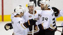Anaheim Ducks' Andrew Cogliano, from left to right, Saku Koivu, of Finland, and Daniel Winnik celebrate Koivu's goal against the Vancouver Canucks during second period NHL hockey action in Vancouver, B.C., on Saturday, March 29. (DARRYL DYCK/THE CANADIAN PRESS)