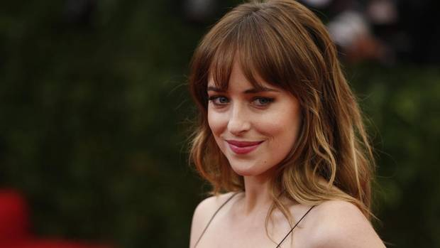 """Fifty Shades of Grey- Actress Dakota Johnson arrives at the Metropolitan Museum of Art Costume Institute Gala Benefit celebrating the opening of """"Charles James: Beyond Fashion"""" in Upper Manhattan, New York, May 5, 2014. The first trailer for the movie version of E.L. James's novel depicts Jamie Dornan and Dakota Johnson coyly getting to know each other – then come the handcuffs. (youtube.com) (© Lucas Jackson / Reuters/REUTERS)"""