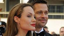 Brad Pitt and Angelina Jolie pose at the premiere of Inglourious Basterds at Cannes Film Festival early last year. The couple is reportedly finalizing a separation worth $330-million (U.S.) (ANNE-CHRISTINE POUJOULAT)