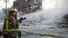 Firefighters fight a six-alarm fire that destroyed buildings in Toronto Wednesday, Feb.20, 2008. (Adrian Wyld/The Canadian Press)
