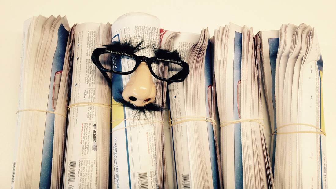 A newspaper with Groucho Marx glasses.