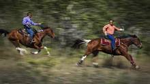 Jimmy Lulua , left, and Roger William battle for second during the first heat of the mountain race at Nemiah Valley Rodeo Aug. 4, 2012. (John Lehmann/The Globe and Mail)