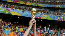 A Netherlands fan holds up a trophy during the 2014 World Cup quarter-finals between Costa Rica and the Netherlands at the Fonte Nova arena in Salvador July 5, 2014. (PAUL HANNA/REUTERS)