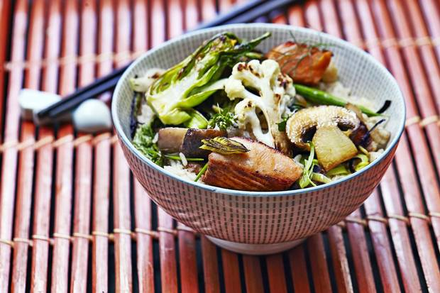 Rice bowls, such as this one with salmon, are a great way to repurpose leftovers.