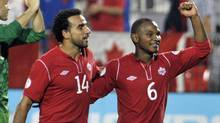 Canada's Dwayne De Rosario, left, and Julian De Guzman celebrate their win against Panama during their 2014 World Cup qualifying soccer match in Toronto September 7, 2012. (Reuters)