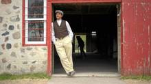 Sheldon Matsalla in the doorway of the 105-year-old barn at the Motherwell Homestead. (Mark Taylor for The Globe and Mail/Mark Taylor for The Globe and Mail)