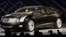 General Motors introduces the auto maker's Cadillac XTS Platinum Concept vehicle during press days of the North American International Auto show at Cobo Center in Detroit. (REBECCA COOK/REUTERS)