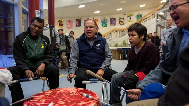 Stephen Wood, second from left, leads a morning drum circle at Ermineskin Junior Senior High School in Maskwacis, Alta. Mr. Wood is a Cree language teacher at the school and his drum group, Northern Cree just received its seventh Grammy nomination.