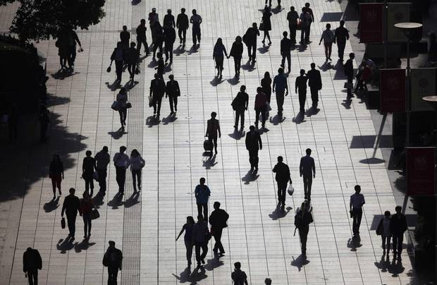 People walk along a pedestrian street in downtown Shanghai in 2013.