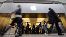People walk by the Apple Store in the Eaton Centre shopping mall in Toronto, March 16, 2012. (MARK BLINCH/Mark Blinch/Reuters)