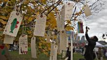 Protesters hang tags with their comments on a tree during a demonstration against the Northern Gateway Pipeline in Vancouver, British Columbia November 16, 2013. About 2,000 protesters gathered to voice their opposition to the pipeline planned to cross northern British Columbia from Alberta to the west coast. (ANDY CLARK/REUTERS)