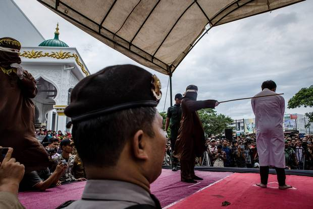 An Indonesian man is caned in public for having gay sex, which is against Sharia law, at Syuhada mosque in Banda Aceh, Indonesia on May 23, 2017