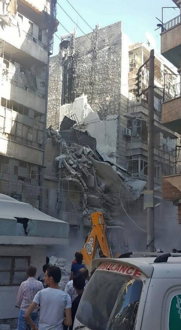 This Twitter photo from Bana Alabed's Twitter account shows a collapsed building in her neighbourhood.