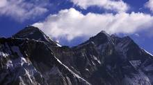 Clouds rise behind Mount Everest, the world's highest peak at 8,848 metres. (GOPAL CHITRAKAR/Reuters)