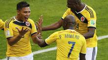 Colombia's Teofilo Gutierrez (L) celebrates with teammates Pablo Armero and Victor Ibarbo (R) after scoring a goal during their 2014 World Cup Group C soccer match against Greece at the Mineirao stadium in Belo Horizonte June 14, 2014. (LEONHARD FOEGER/REUTERS)