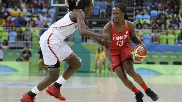 Canada forward Tamara Tatham drives on Senegal forward Mame Marie Sy during the first half of a women's basketball game at the Youth Center at the 2016 Summer Olympics in Rio de Janeiro, Brazil, Wednesday, Aug. 10, 2016.