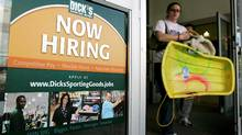 "A customer walks past a ""now hiring"" poster on the door of a Dick's sporting goods store in in Aurora, Ohio. (Amy Sancetta/AP Photo/Amy Sancetta)"