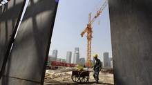 A labourer works at a construction site in Beijing's central business district in this photo from April. China's exports were up 8.7 per cent, year-on-year, in May, fuelled mostly by trade with the United States. (JASON LEE/REUTERS)