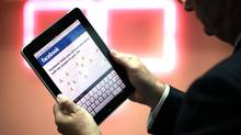 Facebook Inc. has revamped its apps to make the site more accessible for mobile device users. (Jason Alden/Bloomberg)