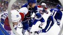 Montreal Canadiens Josh Gorges and Brian Gionta (2nd R) battle for the puck with Toronto Maple Leafs' Joffrey Lupul (2nd L) and Phil Kessel (R) during the second period of their NHL hockey game in Toronto October 6, 2011. REUTERS/Mark Blinch (Mark Blinch/Reuters)
