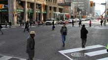 Pedestrians use the new 'scramble crossing' at the intersection of Bloor and Bay streets in Toronto, Ont. November 03, 2010. It is the third downtown intersection to employ the crossing system. (Fernando Morales/The Globe and Mail/Fernando Morales/The Globe and Mail)