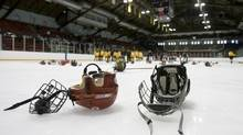 Hockey helmets are seen in this file photo. (Peter Power/The Globe and Mail)