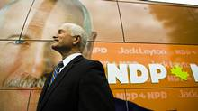 New Democratic Party Leader Jack Layton stands next to his campaign bus at the Bathurst subway station in Toronto on Sept. 29, 2008. (MARK BLINCH/Reuters)