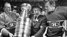 Montreal Canadiens coach Toe Blake, centre, re-enact in 1983 the team's fifth Stanley Cup title with Maurice (The Rocket) Richard and Jacques Plante, right. (CP)