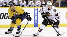 Chicago Blackhawks right wing Patrick Kane (88) moves past Nashville Predators defenseman Shea Weber (6) in the first period of an NHL hockey game, Sunday, Feb. 10, 2013, in Nashville, Tenn. (Mark Humphrey/AP)