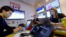 A war room, set up in an office at PR agency Edelman Toronto to monitor and live market the Sochi 2014 Winter Games is photographed as workers Tweet and Facebook messages on Feb. 20 2014. (Fred Lum/The Globe and Mail)