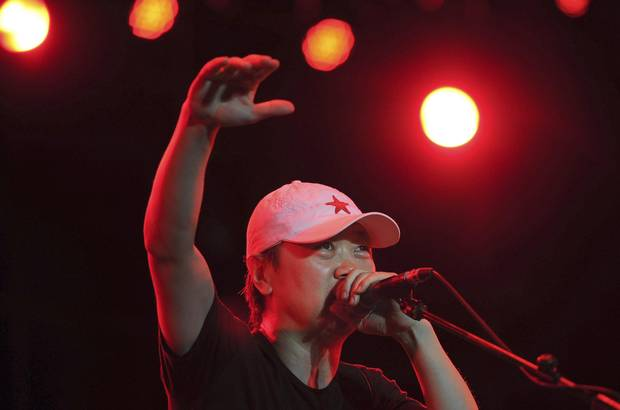 Cui Jian gestures as he sings during a performance at the Play Rock Music Festival in Hefei, Anhui province, in 2012.