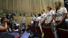 Members of the Canadian Youth Delegation protest as Environment Minister Peter Kent addresses the United Nations climate change talks in Durban. The organization released the photo on Dec. 7, 2011. (HANDOUT/REUTERS)