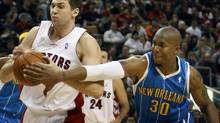 Andrea Bargnani (left) has agreed to a five-year contract with the Toronto Raptors. (MIKE CASSESE/Reuters)