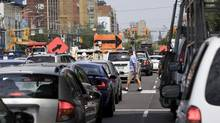 Traffic congestion at King Street West and Spadina Avenue on Aug. 6, 2013. (GLORIA NIETO/THE GLOBE AND MAIL)