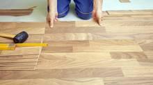 Floor installation, home renovation. (Photos.com)