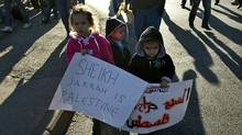 Palestinian children hold anti-Israeli occupation slogans during a weekly demonstration in the mostly Arab Jerusalem neighborhood of Sheikh Jarrah on January 21, 2011 . (AHMAD GHARABLI/Ahmad Gharabli/AFP/Getty Images)