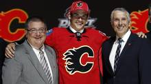 Sean Monahan poses with Calgary Flames executives after being selected by the Flames as the sixth overall pick in the 2013 National Hockey league (NHL) draft in Newark, New Jersey, June 30, 2013. (BRENDAN MCDERMID/REUTERS)