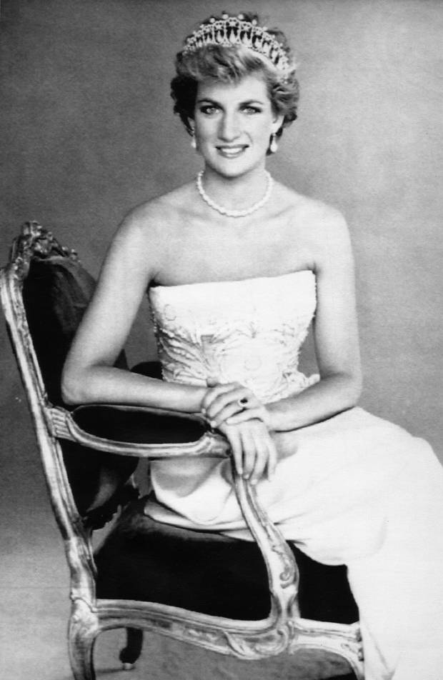 Princess Diana sits regally in an armchair for the new official portrait by photographer Patrick Demarchelier issued by Buckingham Palace Saturday. The Princess of Wales wears a pearl-drop tiara which once belonged to Queen Mary and a strand of pearls.