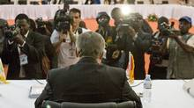 Members of the press record Prime Minister Stephen Harper as he delivers his closing remarks at the Commonwealth Heads of Government meeting in Kampala, Uganda, on Nov 25, 2007. (Tom Hanson/The Canadian Press)