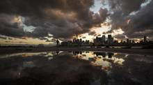 A looks out at Toronto in July. The city just gave the green light to a massive amount of urban development. (Mark Blinch for The Globe and Mail)