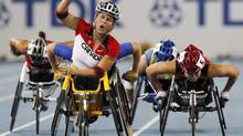 Canada's Diane Roy , foreground left, celebrates winning the Women's 800m Wheelchair final ahead of Japan's Wakako Tsuchida, right, at the World Athletics Championships in Daegu, South Korea, Sept. 3, 2011. (Anja Niedringhaus/AP)