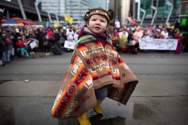 Maelona Williams, 1, attends a Women's March with her father in Vancouver on Jan. 20, 2018.